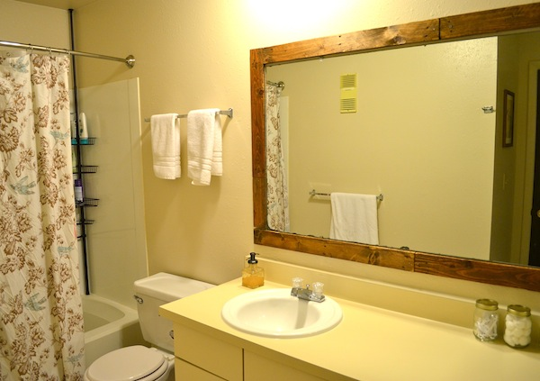 Framing A Bathroom Mirror with Pallets from Rachel Schultz