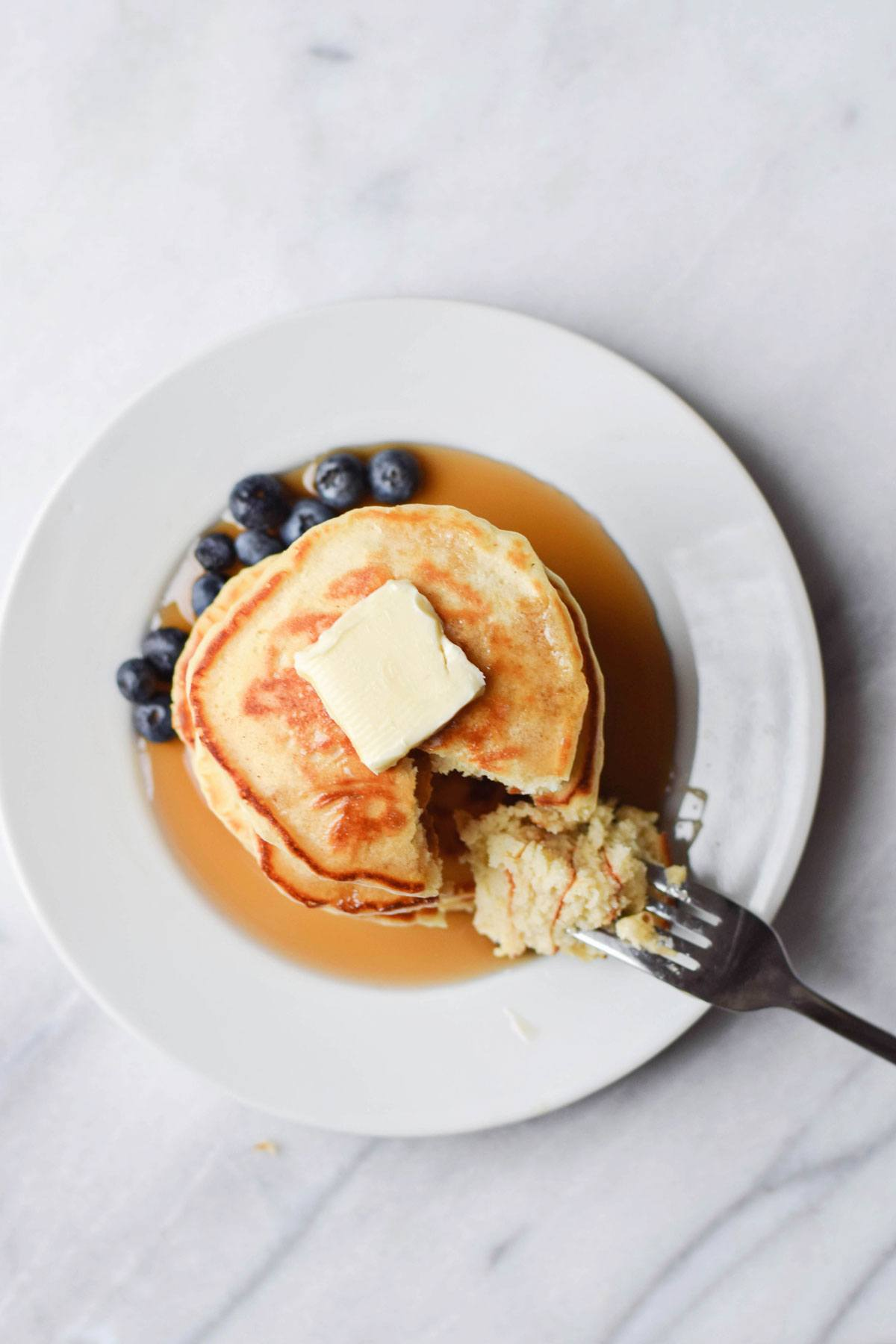 Old Fashioned Pancakes with Syrup, Butter, and Blueberries