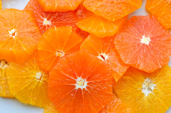 peel and slice citrus and arrange on plates